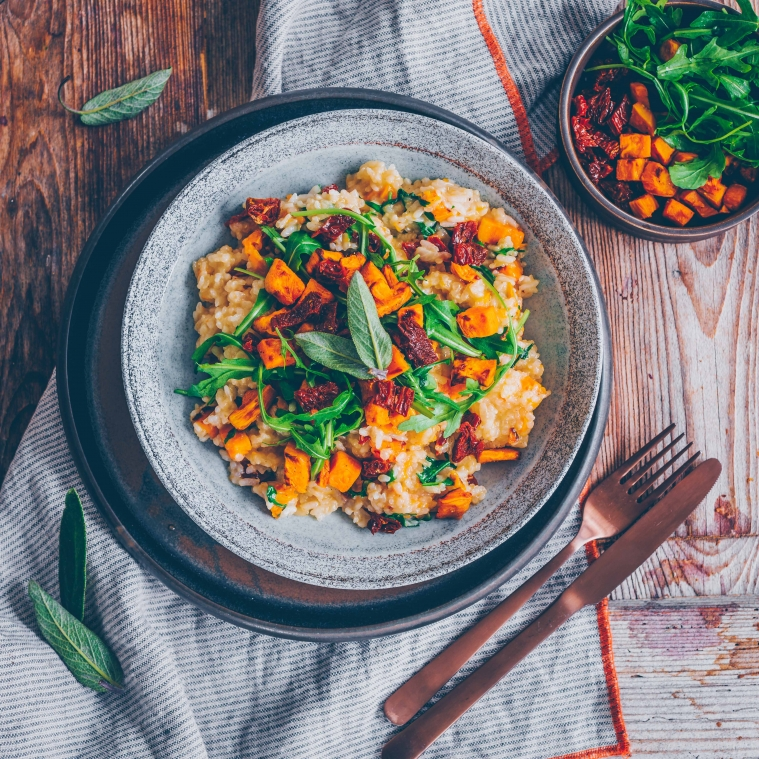 Sweet potato risotto with arugula and dried tomatoes